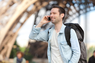 Young attractive tourist phoning in Paris