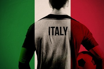 Composite image of italy football player holding ball