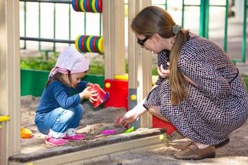 Mother Enjoys Time With Her Doughter At Playground