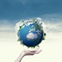 Female hand hold 3D rendered Earth globe. Environmental backgrou