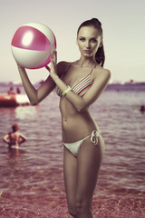 bikini woman with beach ball