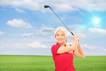 Woman playing golf in a field