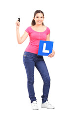 Girl holding an l sign and a car key