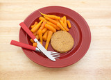 Diet meal on red plate with silverware