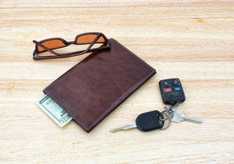 Sunglasses with car keys and wallet