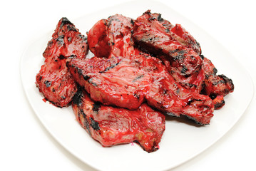 Chinese Stickt Barbeque Spareribs on a White Plate