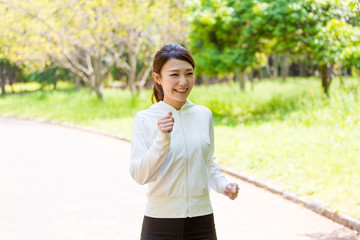 young asian woman jogging in the park