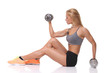 sporty girl doing exercise with dumbbells