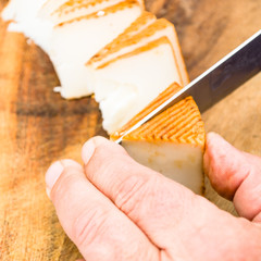 man cutting cheese