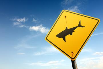 Sharks ahead. Yellow traffic sign.