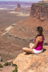 Girl sitting at the edge of the Canyon