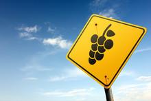 Vineyards ahead. Yellow traffic sign.