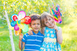 Cheerful kids with pinwheels