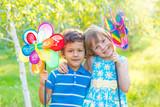 Cheerful kids with pinwheels