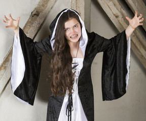 young woman dressed as a witch