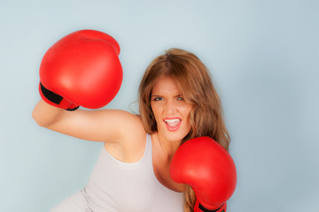 sexy woman in vest wearing red boxing gloves