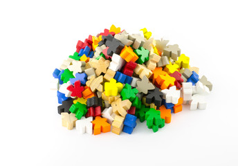 Pile of colourful wooden organic shape piece  on white backgroun