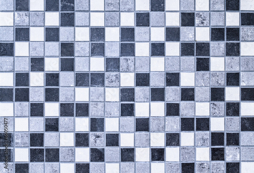 Small square stone tiles in black, white and gray colors.