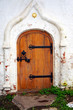 Closed wooden door - Detail of old white church