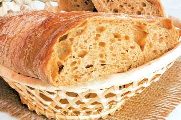 the cut bread in a wattled basket