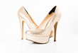 fashion gold female high heeled shoes on white isolated - 66051883
