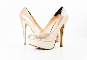 fashion gold female high heeled shoes on white isolated