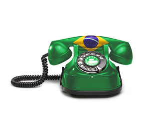 Office: old and vintage telephone with the Brazil flag