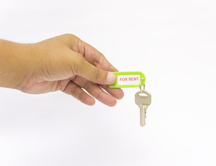 Hand holding For Rent tag and keys