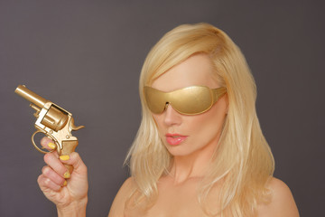 Girl With Blonde Hair Holding a Gun
