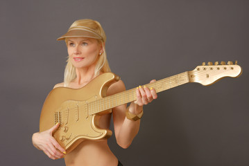 Woman With Blonde Hair Holding Guitar