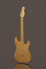 Gold Electric Guitar on Dark Background