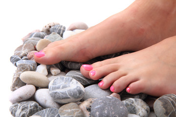 womens legs (nails) and stones (pedicure)
