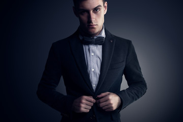 Portrait of attractive handsome stylish fashion young man in