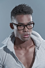 Black african man. Eyewear fashion. Studio shot against grey.
