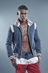 Black african fitness man wearing blue jacket and striped shorts