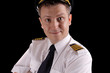 Cheerful captain in uniform on a black background - 66057432