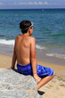 Boy on the sea beach.