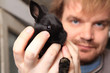 man nad small black  bunny