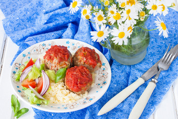 meatballs with tomato sauce, vegetables and a side dish