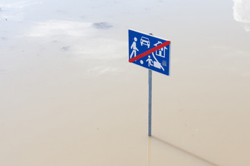 flooded traffic sign