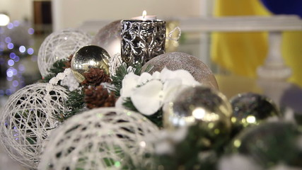 Decoration of Christmas balls, cones and candle