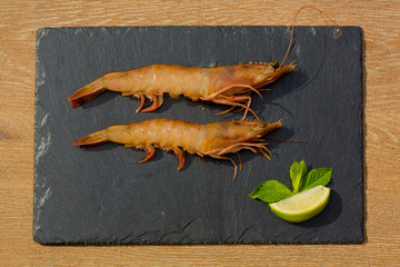 Organic Tiger shrimps on black stone background