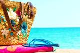 Beach necessities,against blue sea horizon poster