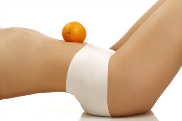 Closeup of a perfect girl showing a fruit on her body