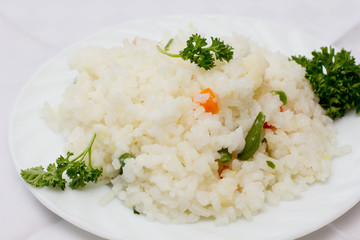 Plate full of rice on white