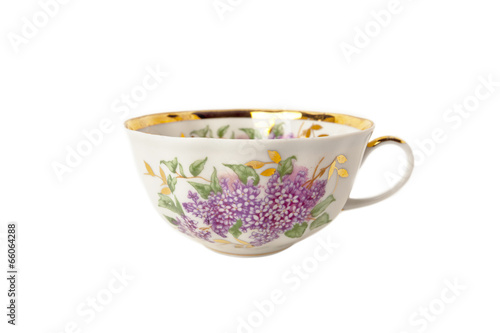 Porcelain teacup with floral ornament on white