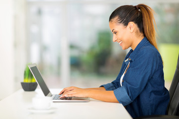 cheerful woman using laptop computer