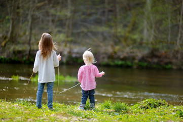 Two little sisters by a river