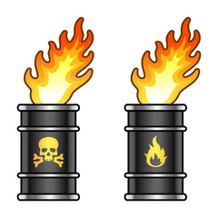Metal oil barrels in flame with danger signs