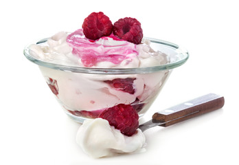 fresh raspberries in sweet sour cream on a white background